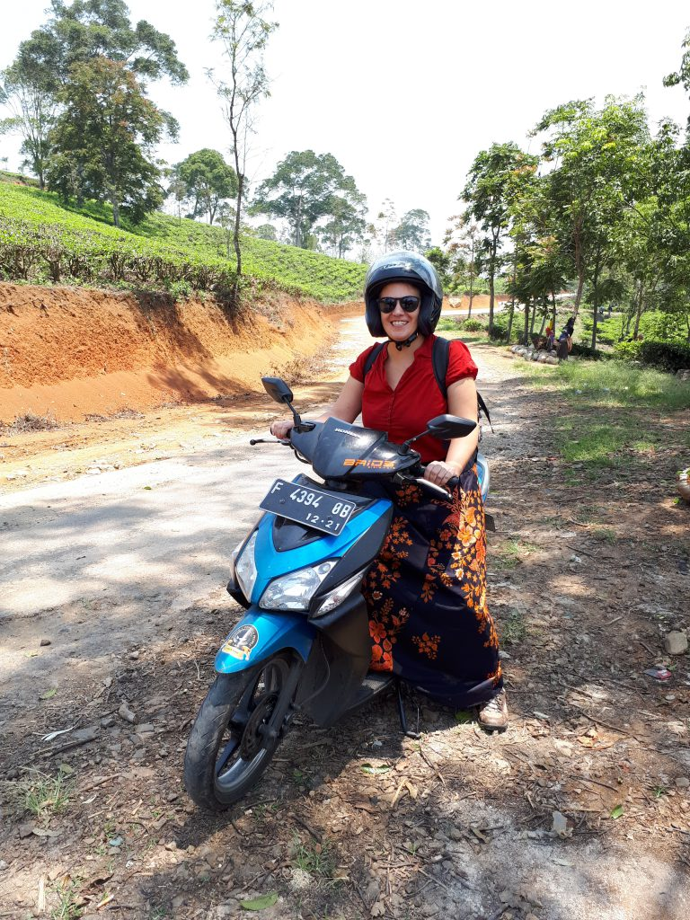Driving on a scooter in the moutains of Cianjur.